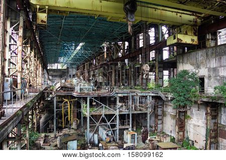 Abandoned, destroyed by war and owergrown machinery of Tkvarcheli power plant, Abkhazia, Georgia