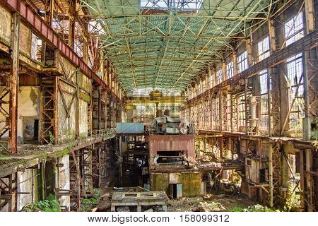 Abandoned, destroyed by war and overgrown machinery of Tkvarcheli power plant, Abkhazia, Georgia