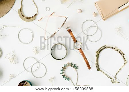 woman trendy fashion accessories arrangement on white flat lay top view