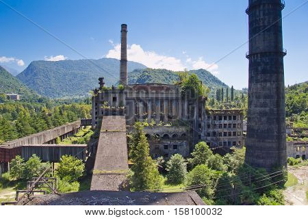 Abandoned, destroyed by war and overgrown Tkvarcheli power plant, Abkhazia, Georgia