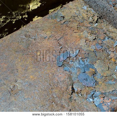Flakes Of Rust On A Sheet Of Rusty Iron. Background Of Rust. Corrosion Of Metal