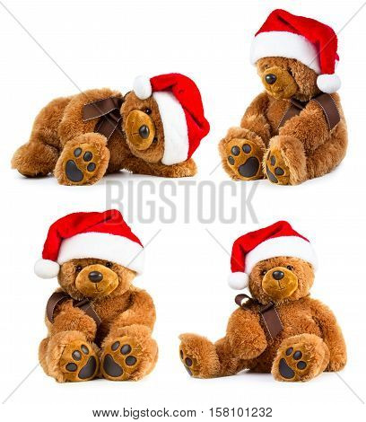 Four toy teddy bear wearing a santa hat isolated on white background