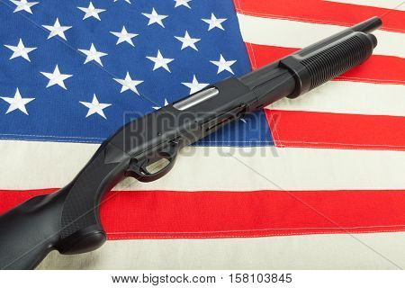 Shotgun without labels on USA flag - studio shot