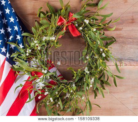 Christmas wreath with mistletoe and american flag. Christmas decoration