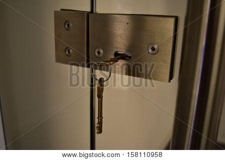 KEYS CHAIN KNOB, AND LOCKED GLASS DOOR