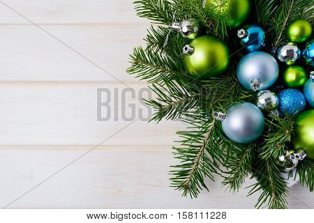 Christmas background with blue glitter ornaments. Christmas decoration with shiny bauble hanging. Copy space.