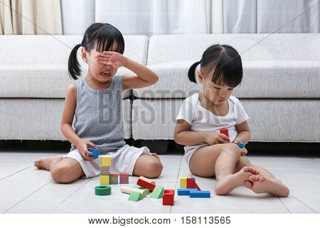 Asian Chinese Little Sisters Struggle For Blocks