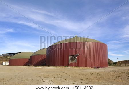 A plant biogas on the top there is a cow farm