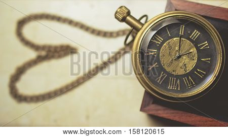 old pocket watch with chain in heart shape vintage tone