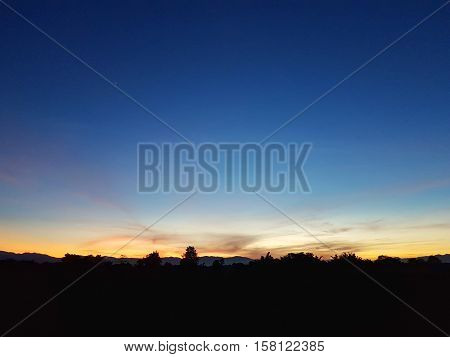 sunset background with sillhouette foreground evening scene