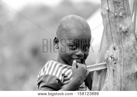 TORIT, SOUTH SUDAN-FEBRUARY 20 2013: Unidentified boy in the village of Torit, South Sudan. Children suffer poverty due to the unstable political situation.