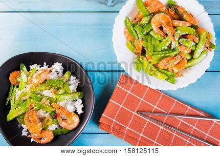 prawn and snow peas on topped of the rice