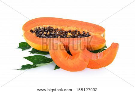 half cut ripe papaya with seed on leaf with white background