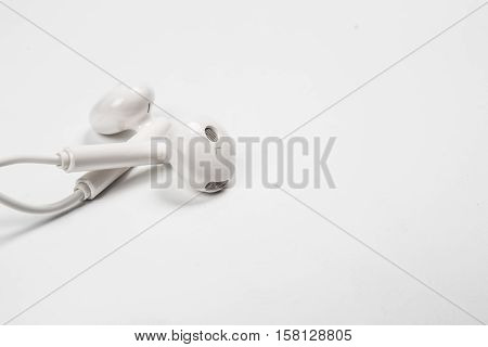 Earphone or earphones on white background.the white earphones for using digital music or smart phone.
