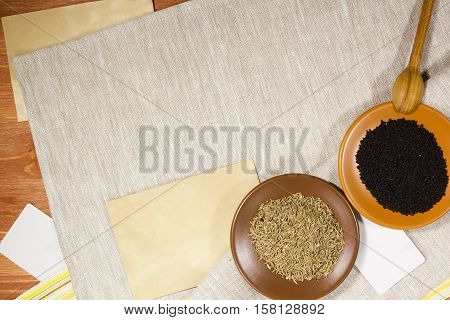 Cumin seeds and conventional black on linen napkin