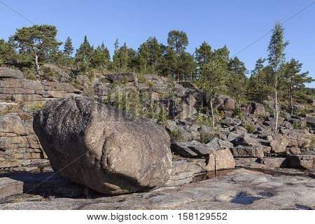 Coast and coastline at UNESCO, High Coast Heritage, Sweden. Huge stones, rocks and cliffs along the coast. Isostasy close to one cm per year.