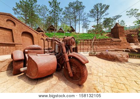Big Clay Sculpture Of Motorcycle With Sidecar In Clay Town