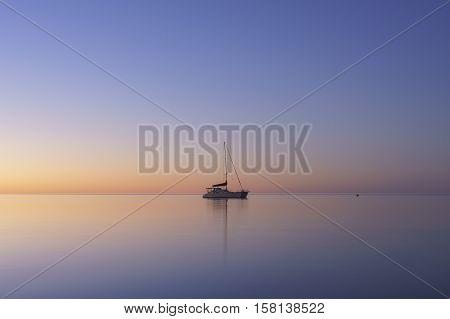 Yacht in still water during sunset at Monkey Mia, Western Australia, Australia.