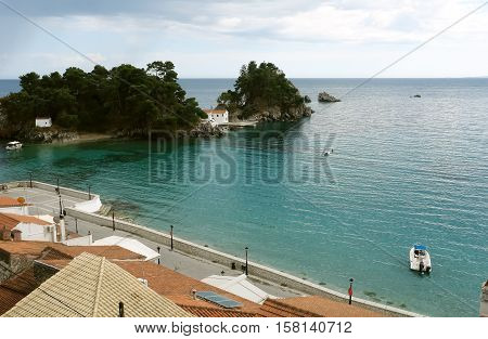 Parga GREECE May 09 2013: Landscape with church in bay of Parga town on the coast of Ionian sea Greece.
