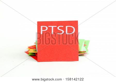 picture of a red note paper with text ptsd