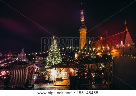 TALLINN ESTONIA - NOVEMBER 20 2016: Traditional winter holidays market in Tallinn old town. Very long history dating back to 1441 when the first Christmas tree was displayed in Tallinn.