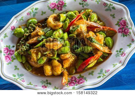 Stir fried prawns in Thai spicy curry with other Thai herbal ingredients.