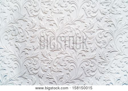 White plaster relief background floral pattern in baroque style