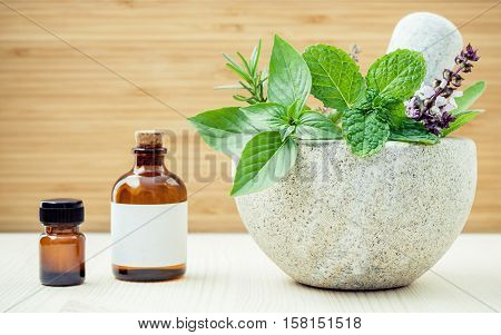 Alternative Health Care And Herbal Medicine .fresh Herbs And Aromatic Oil With Mortar And Pestle On