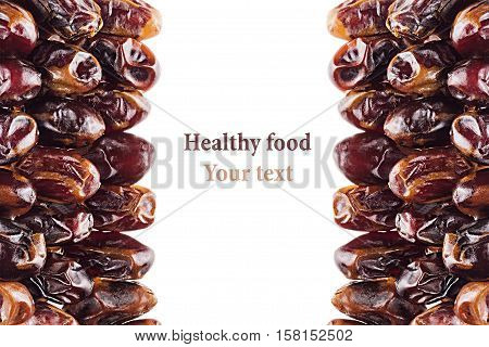 Date fruit closeup on white background. Isolated. Decorative border of shiny date fruit. Dried fruit for vegetarian.