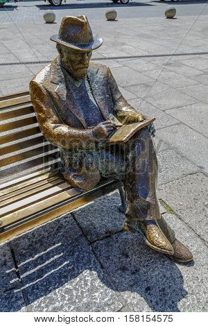 Leon Spain - August 27 2016: Bronze statue of Antonio Gaudi in Leon by Jose Luis Fernandez his work Against House Treads is the only building designed and built by Gaudi in the city of Leon.
