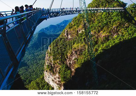 Photo of the Breathtaking tourist attraction Sky bridge symbol Langkawi island. Adventure holiday. Modern construction. Travel concept.