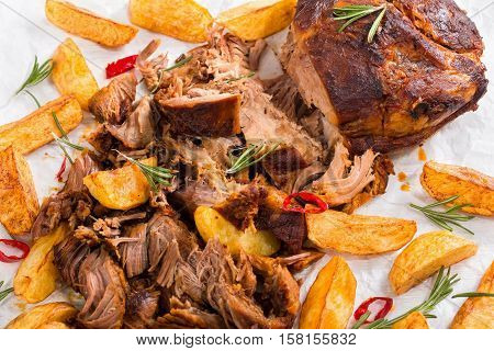 Pulled Slow-cooked Meat Grilled In Oven With Fried Potato Wedges