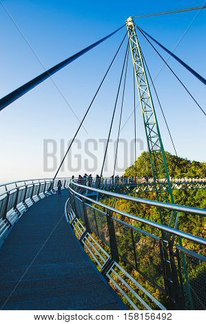 Photo of the Construction famous langkawi bridge in sunset time. Adventure holiday. Modern construction. Tourist attraction. Travel concept. Cable-stayed bridge