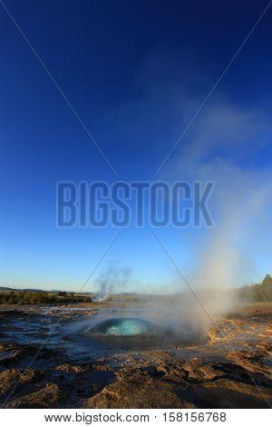Strokkur Geysir Starting Eruption in the Iceland