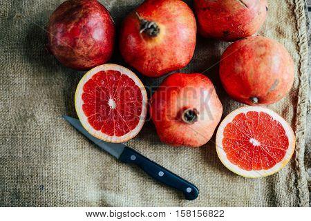 Ripe Pomegranate Fruit On Wooden Vintage Background. Red Juice P