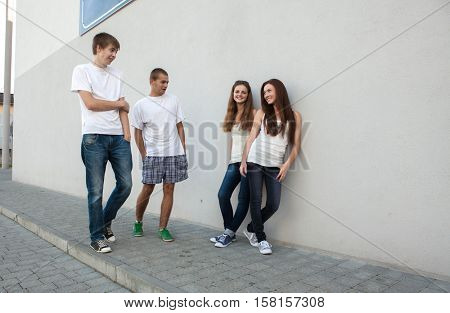 teen boys get acquainted with the girls on the street