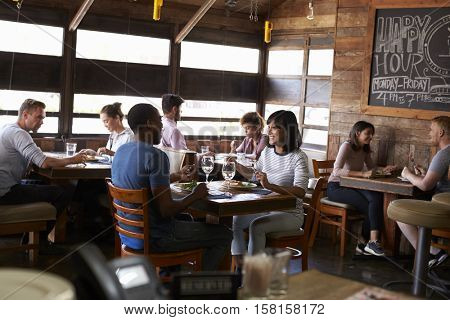 Couples enjoying lunch in a busy restaurant