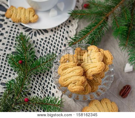 German sweet Christmas cookies Spritz with tea