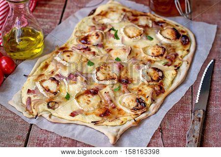 French traditional dish tarte flambee Flammekueche with goat cheese