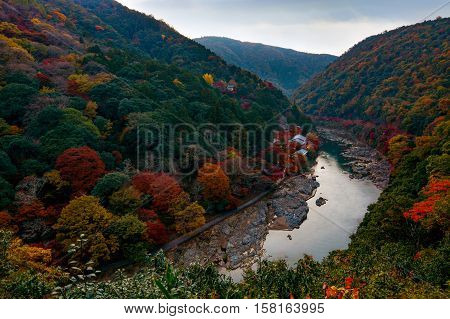 Autumn colors along the Katsura River in the Arashiyama area of Kyoto, Japan just after sunset