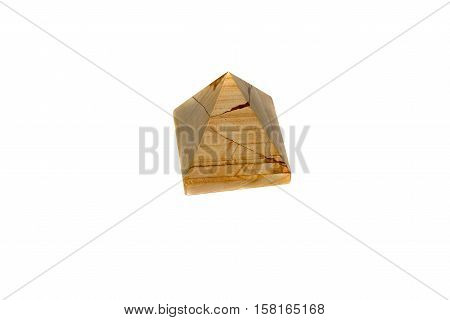 A pyramid of marble onyx isolated on white background. Pyramid made of natural onyx.