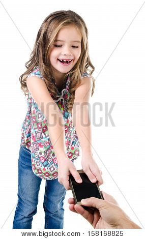 Happy little girl is taking mobile phone isolated on a white technology and internet concept