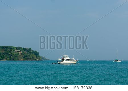 Beautiful landscape seaview with a boat at beach of Laem Panwa Cape famous attractions in Phuket island Thailand