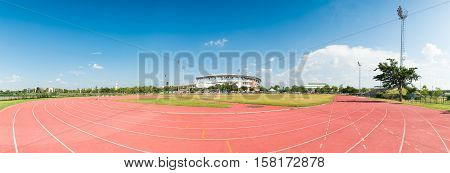 Red running track in stadium. Running track on blue sky. field run in stadium background.