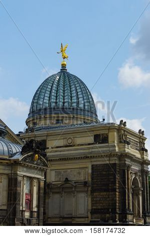 DRESDEN, GERMANY - JULY 13, 2015: the Academy of Fine Arts - glass cupola with gold angel - Dresden - Germany
