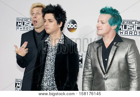 Mike Dirnt, Billie Joe Armstrong and Tre Cool of Green Day at the 2016 American Music Awards held at the Microsoft Theater in Los Angeles, USA on November 20, 2016.