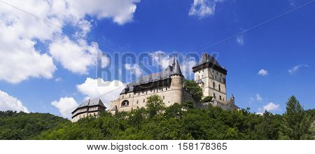 Karlstejn Castle: a large Gothic castle in Czech Republic. Panorama photo. Summer time