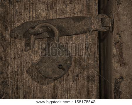 Grange lock on wooden door. Toned Image