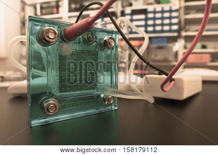 Hydrogen fuel cell, A fuel cell is a device that converts the chemical energy from a fuel into electricity. Toned Image