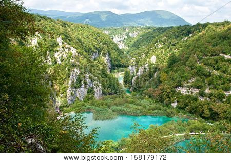 Lower lakes canyon. Hiking path meandering between two lakes with turquoise water. View from above. Plitvice lakes national park Croatia